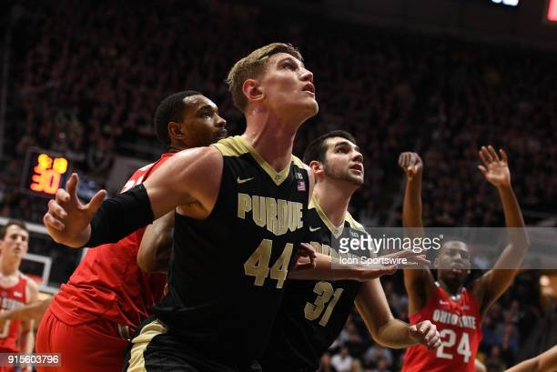 Purdue Boilermakers center Isaac Haas looks to rebound as Ohio State Buckeyes forward Andre Wesson shoots a free throw during the Big Ten Conference...