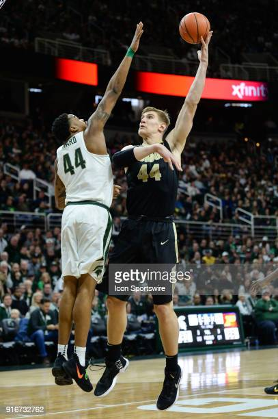Purdue Boilermakers center Isaac Haas shoots a hook shot over Michigan State Spartans forward Nick Ward during a Big Ten Conference college...