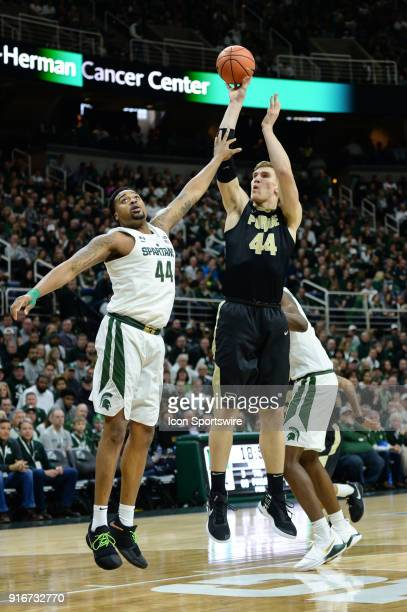 Purdue Boilermakers center Isaac Haas shoots a jumper over Michigan State Spartans forward Nick Ward during a Big Ten Conference college basketball...