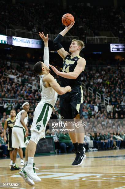 Purdue Boilermakers center Isaac Haas shoots over the top of Michigan State Spartans forward Gavin Schilling during a Big Ten Conference college...