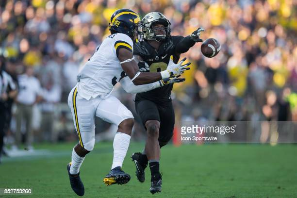 Purdue Boilermakers cornerback Josh Okonye knocks a ball away from Michigan Wolverines wide receiver Donovan PeoplesJones during the college football...