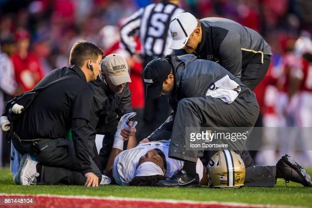 Purdue Boilermakers defensive tackle Eddy Wilson goes down with an injury durning an college football game between the Purdue Boilermakers and the...