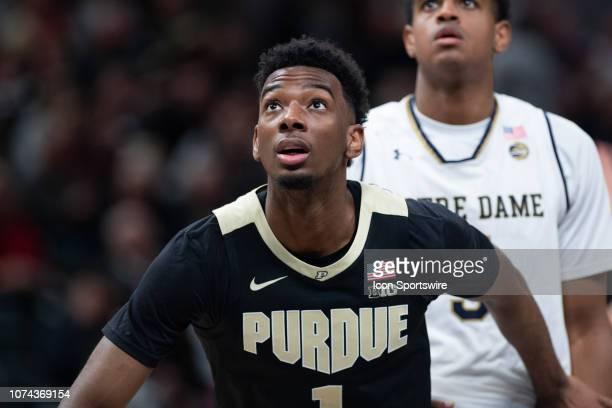 Purdue Boilermakers forward Aaron Wheeler blocks out Notre Dame Fighting Irish guard DJ Harvey during the Crossroads Classic basketball game between...
