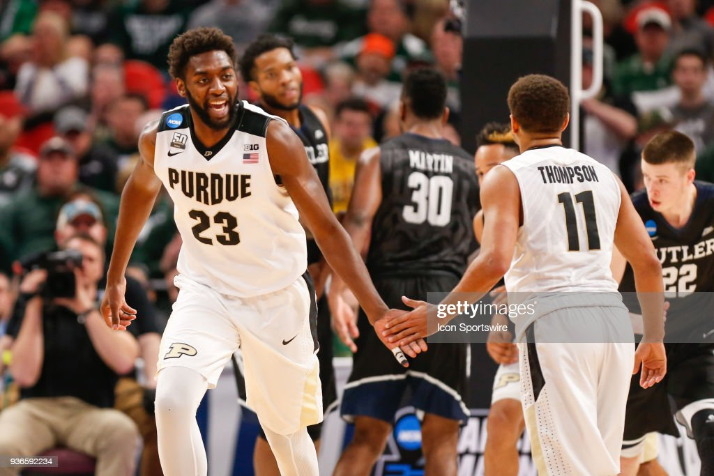 Purdue Boilermakers forward Jacquil Taylor slaps hands with Purdue ...