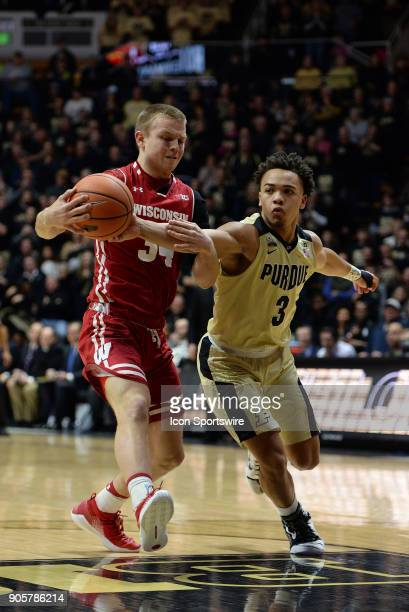 Purdue Boilermakers guard Carsen Edwards and Wisconsin Badgers guard Brad Davison battle for the ball off of the opening tip off during the Big Ten...