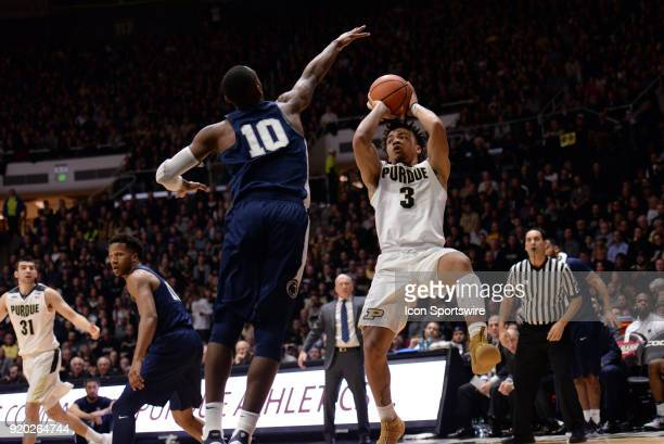 Purdue Boilermakers guard Carsen Edwards gets off balance as he passes the ball during the Big Ten Conference college basketball game between the...