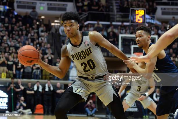 Purdue Boilermakers guard Nojel Eastern passes the ball as Penn State Nittany Lions guard Myreon Jones grabs his wrist during the Big Ten Conference...