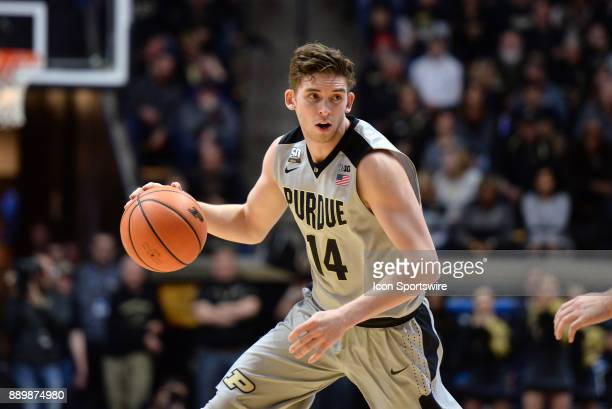 Purdue Boilermakers Guard Ryan Cline dribbles the ball around the three point line during the college basketball game between the IUPUI Jaguars and...