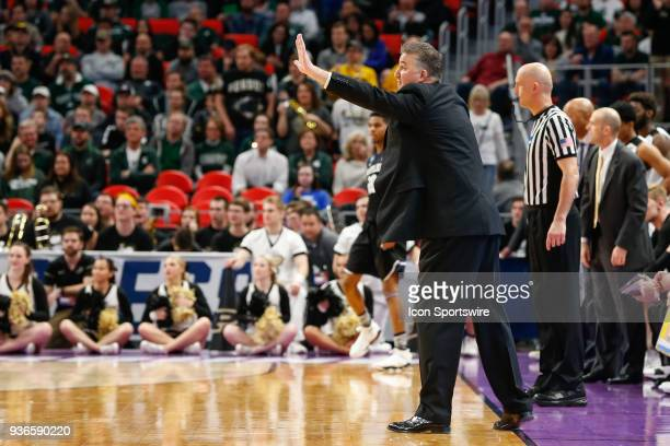 Purdue Boilermakers head coach Matt Painter shouts instructions to his players during the NCAA Division I Men's Championship Second Round basketball...