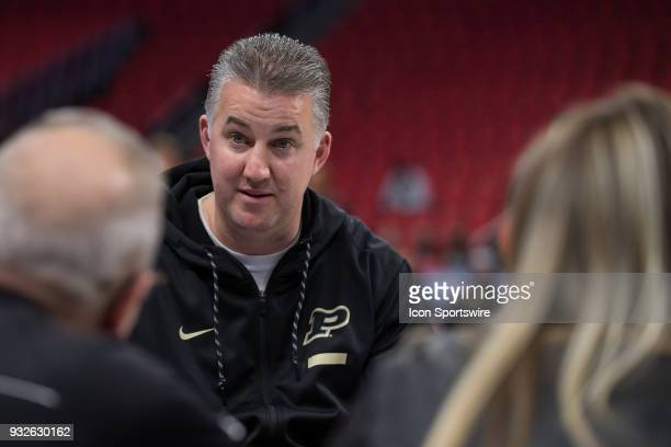 Purdue Boilermakers head coach Matt Painter talks during an interview during an open public practice during the practice day before the first round...