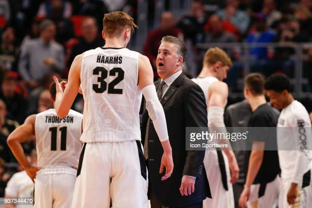 Purdue Boilermakers head coach Matt Painter talks to Purdue Boilermakers forward Matt Haarms during the NCAA Division I Men's Championship First...