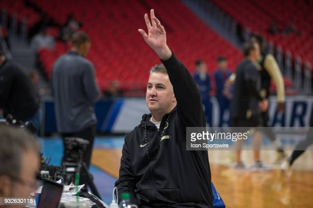 Purdue Boilermakers head coach Matt Painter waves to fans during a interview during an open public practice during the practice day before the first...