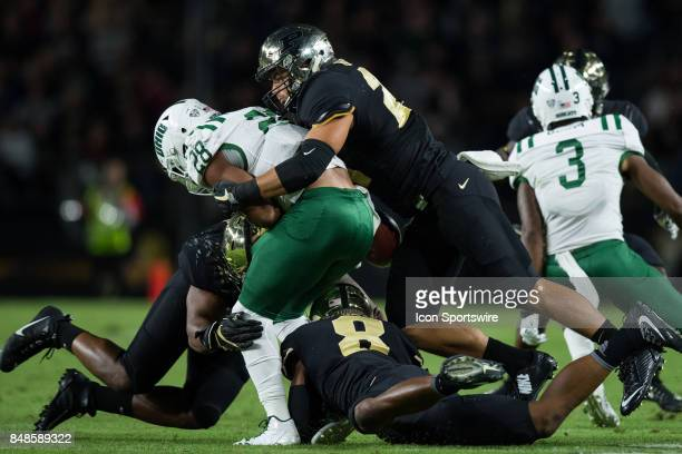Purdue Boilermakers linebacker Markus Bailey and Purdue Boilermakers cornerback Josh Okonye knock the ball away from Ohio Bobcats running back Dorian...