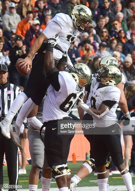 Purdue Boilermakers offensive lineman Dennis Edwards lifts up Purdue Boilermakers quarterback David Blough after he scored in the first quarter...