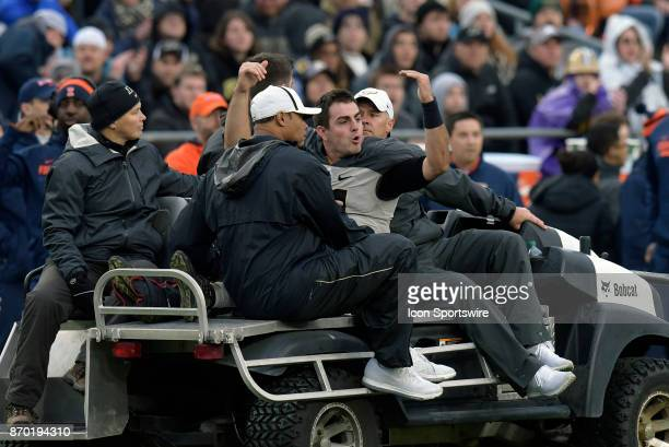 Purdue Boilermakers quarterback David Blough pumps up the crowd as he his carted off the field after being injured during the Big Ten Conference game...