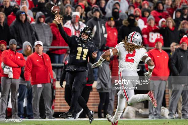 Purdue Boilermakers quarterback David Blough throws downfield as Ohio State Buckeyes defensive end Chase Young gets pressure during the college...