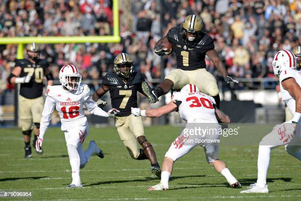 Purdue Boilermakers running back DJ Knox hurdles Indiana Hoosiers defensive back Chase Dutra during the college football game between the Indiana...