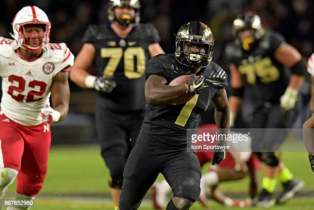 Purdue Boilermakers running back DJ Knox scrambles into the open field during the Big Ten conference game between the Purdue Boilermakers and the...