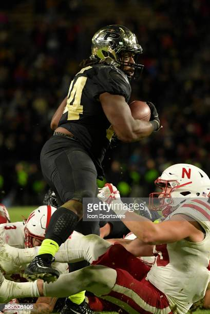 Purdue Boilermakers running back Richie Worship steps over a Nebraska Cornhuskers defender as he rushes up the field during the Big Ten conference...