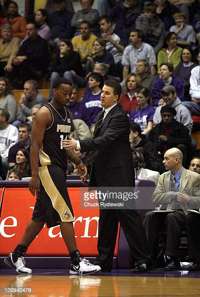 Purdue coach Matt Painter consoles Carl Landry after fouling out versus Northwestern at WelshRyan Arena in Evanston Illinois February 24 2007 The...