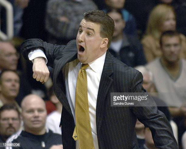 Purdue Coach Matt Painter illustrates what he believes was a foul in Purdue's 8168 win over Indiana at Mackey Arena in West Lafayette Indiana on...