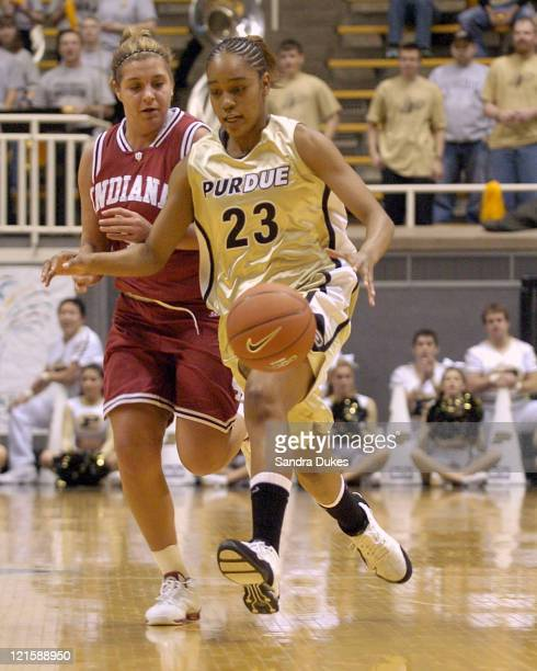 Purdue freshman guard Tye Jackson races the ball up court past Indiana's Nikki Smith in the second half of the game against Indiana at Mackey Arena...