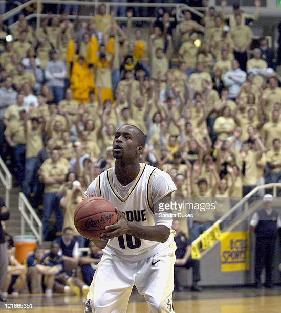 Purdue guard Brandon McKnight sets up for a free throw as the Gene Pool watches behind him Purdue defeated Michigan 8455 at Mackey Arena in West...