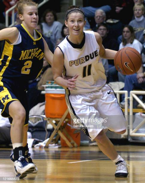 Purdue guard Brina Pollack drives past Michigan guard Becky Flippin Purdue defeated Michigan 6766 at Mackey Arena in West Lafayette Indiana on Sunday...