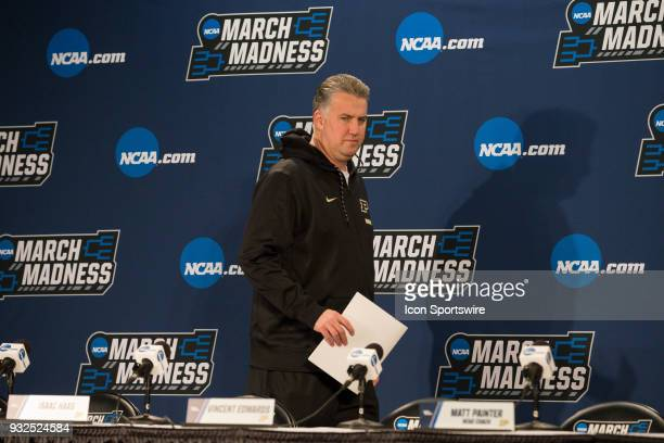 Purdue head coach Matt Painter walks to his seat on the interview platform to speak to the media during a press conference during the practice day...