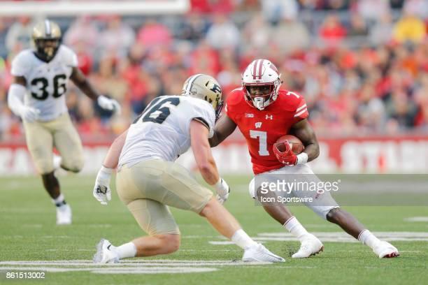 Purdue line backer Garrett Hudson sets up to tackle UW running back Bradrick Shaw during a Big Ten football game between the University of Wisconsin...