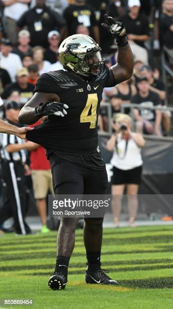 Purdue linebacker Ja'Whaun Bentley yells at the Michigan offense while being escorted off the field after being ejected for targeting in the fourth...