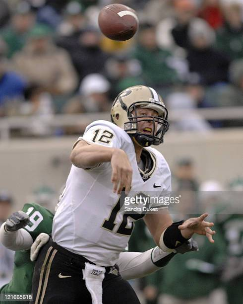 Purdue QB Curtis Painter is hit as he throws under pressure in the 2nd quarter in the Purdue win over Michigan State, 17-15 at Spartan Stadium in...