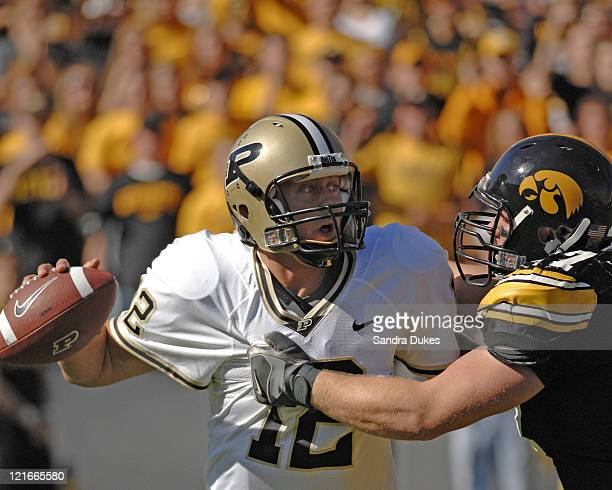 Purdue QB Curtis Painter tries to pass under pressure in the first half Iowa defeated Purdue in Kinnick Stadium in Iowa City Iowa 4717 on October 7...