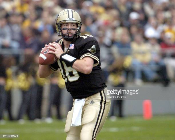 Purdue quarterback Kyle Orton looks to pass for one of his 622 yards in Purdue's 6224 win over Indiana at Ross Ade Stadium West Lafayette Indiana on...