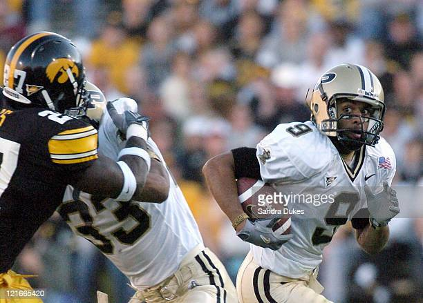 Purdue wide receiver Dorien Bryant eyes the defense as he returns a kick off in the 1st quarter of Iowa's 2321 win against Purdue Saturday November 6...
