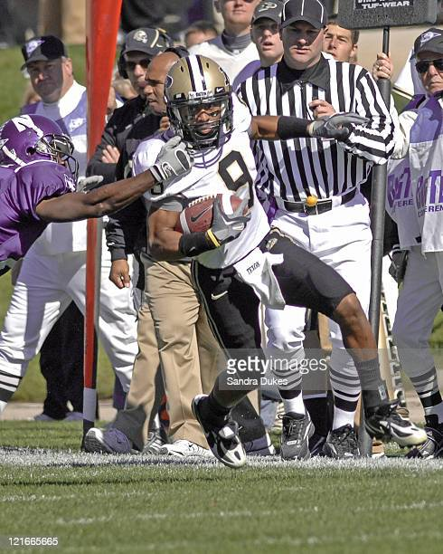 Purdue WR Doriien Bryant tries to run up the sideline after a catch in the game won by Purdue over Northwestern 31-10 at Ryan Field in West...