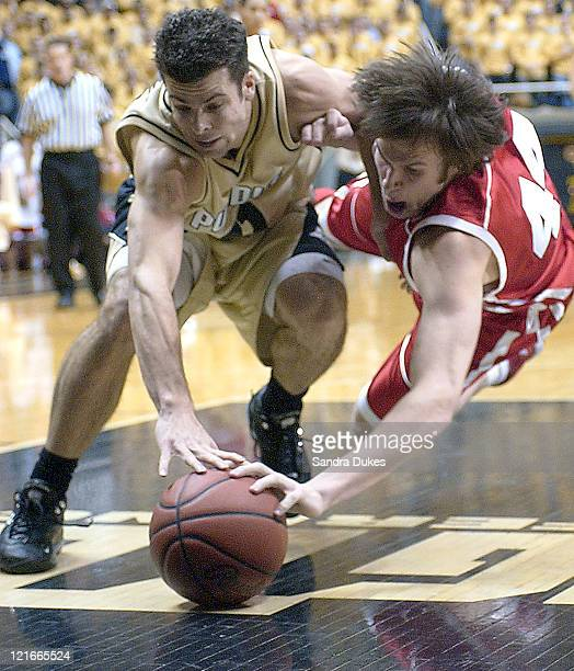 Purdue's Austin Parkinson and Wisconsin's Zach Morley go for a loose ball in the first half of Purdue's 53-51 win.