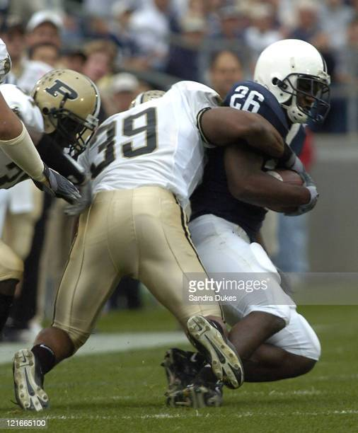 Purdue's Bobby Iwuchukwu hangs on to Tony Hunt in the first quarter of Purdue's 2013 win at Beaver Stadium State College PA October 9 2004