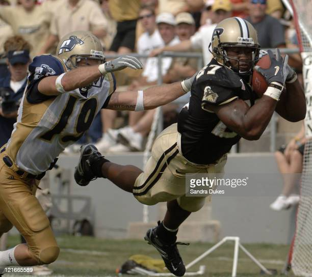 Purdue's Brandon Jones grabs a pass in front of John Mackey in Purdue's 49-24 win over Akron at Ross Ade Stadium in West Lafayette, Indiana on...