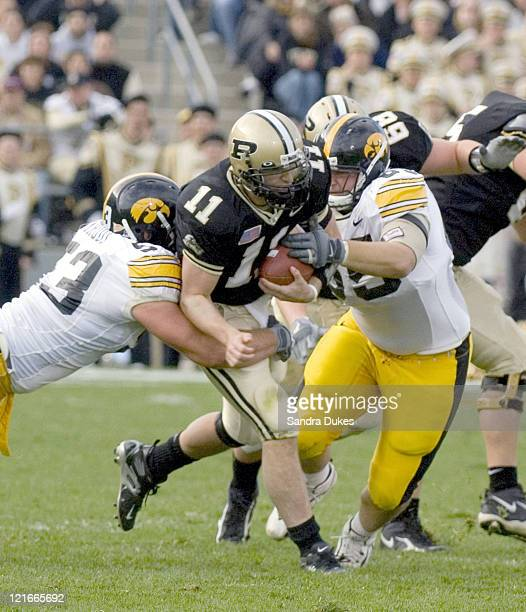 Purdue's Brandon Kirsch is caught by Iowa's linebackers on a run in the first quarter in Iowa's 3417 win over Purdue at Ross Ade Stadium in West...