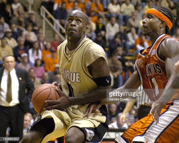 Purdue's Brandon McKnight looks for a shot as Dee Brown defends at the end of the game won by Illinois 6859 at Mackey Arena in West Lafayette Indiana...