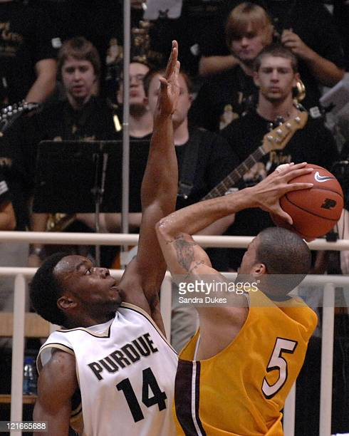 Purdue's Carl Landry defends a shot by Blake Shilb in a game won by Purdue 78-62 over Loyola-Chicago in Mackey Arena, West Lafayette, IN Dec. 5, 2006.