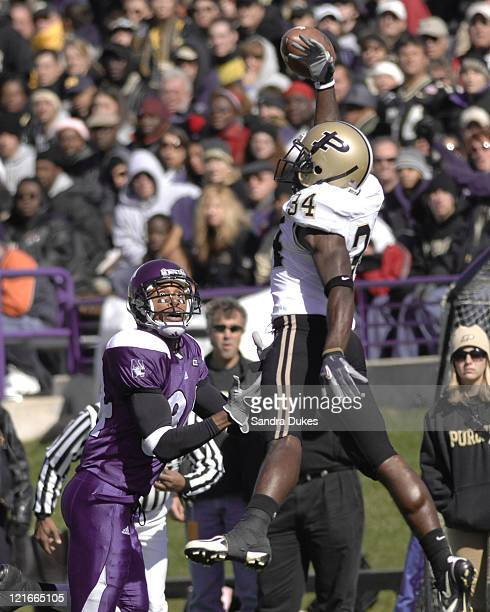 Purdue's CB Terrell Vinson goes high to deflect a pass as Northwestern's Shaun Herbert looks on in the game game won by Purdue over Northwestern...