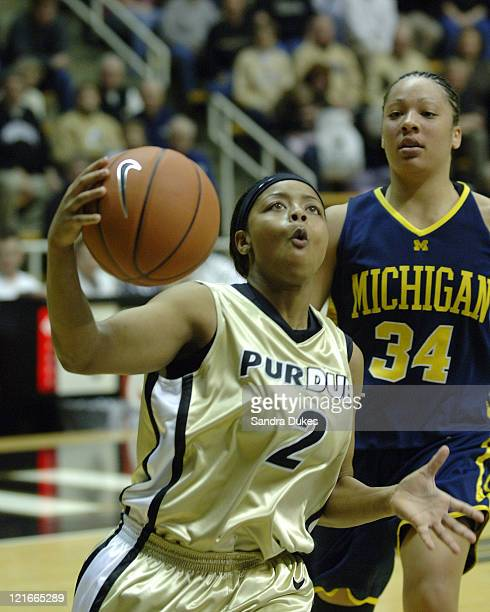 Purdue's Cherelle George rolls past Krista Clement for a layup after a steal in the 2nd half of Purdue's 75-50 win in Big Ten play in Mackey Arena,...