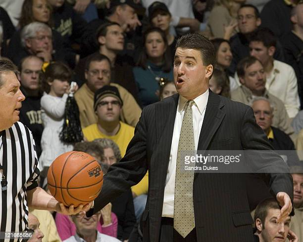 Purdue's Coach Matt Painter discusses a play in Purdue's 7350 win over Northwestern at Mackey Arena in West Lafayette Indiana on March 3 2007