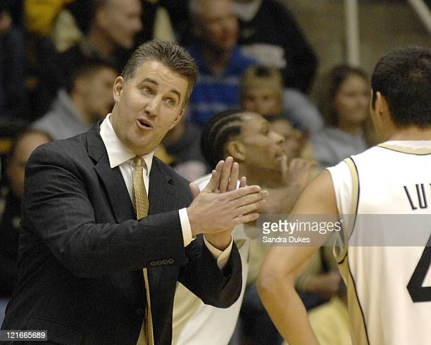 Purdue's Coach Matt Painter encourages Chris Lutz in a game won by Purdue 7862 over LoyolaChicago in Mackey Arena West Lafayette IN Dec 5 2006