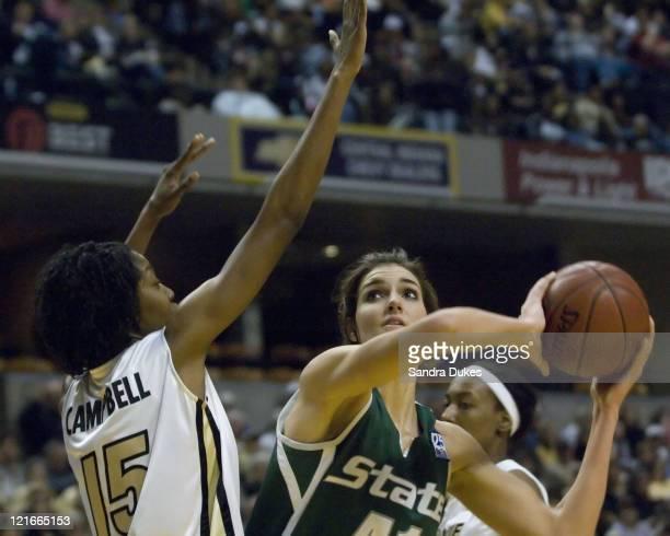 Purdue's Danielle Campbell blocks the way as MSU's Allyssa De Haan drives for the basket during Purdue's 6461 win over MSU in the Women's Big Ten...