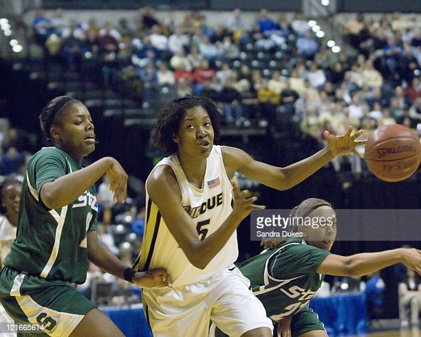 Purdue's Danielle Campbell loses the ball as she drives for the basket during Purdue's 6461 win over MSU in the Women's Big Ten Tournament at Conseco...