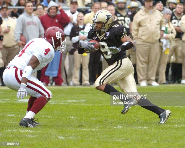 Purdue's Dorian Bryant fakes to the right as he goes for a touchdown in the first quarte in the second quarter in Purdue's 62-24 win over Indiana at...