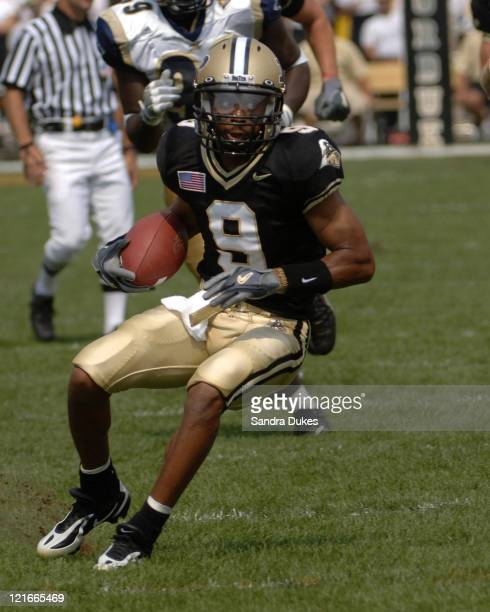 Purdue's Dorian Bryant looks to run after a catch in the first quarter of Purdue's 49-24 win over Akron at Ross Ade Stadium in West Lafayette,...